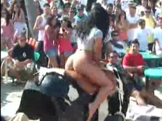 Watch video Hot latin girl riding mechanical bull